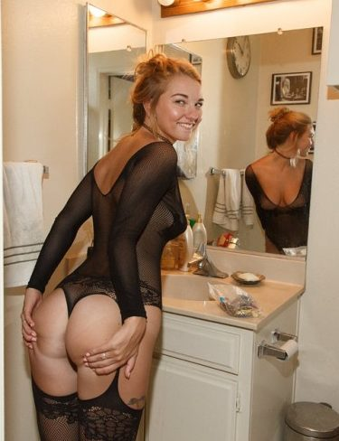 Young Girl In Black Lingerie