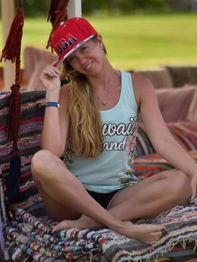 LiveJasmin - Blonde girl in a red cap smiling