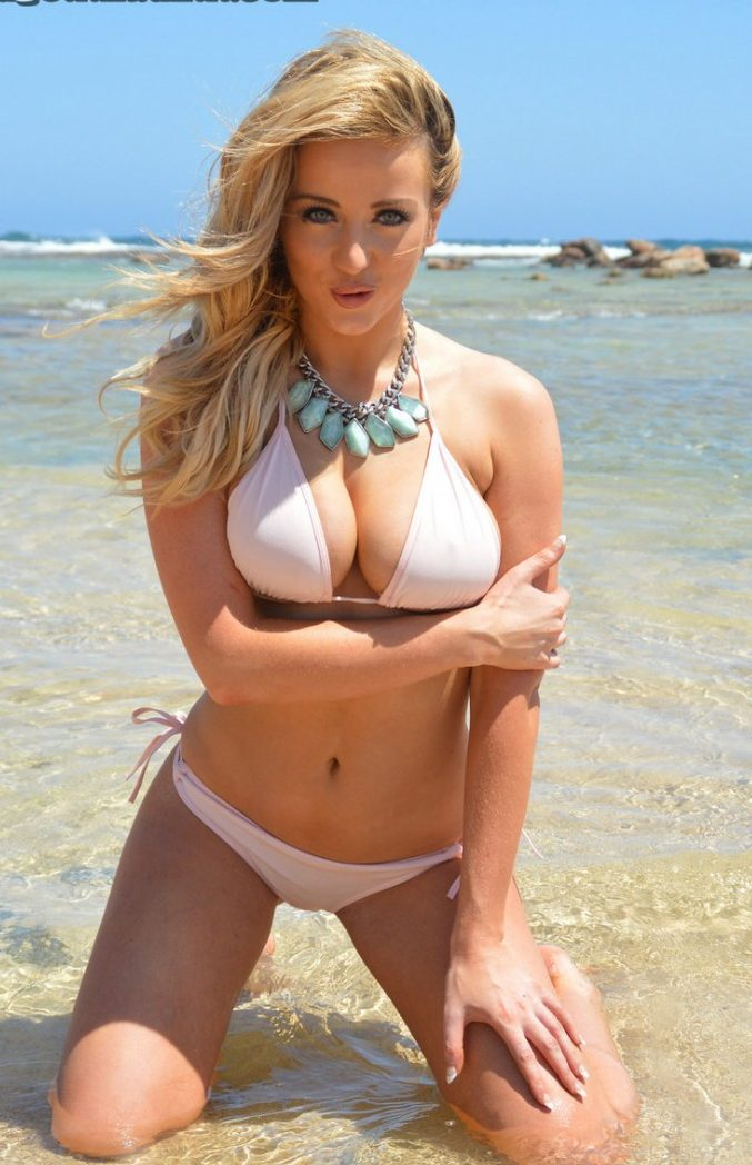 Busty girl Lana strips on the beach for UGotItFlauntIt