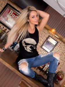 Nikki Sims in Shredded Jeans